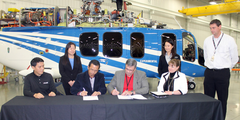 From Left to Right: Front Row: Mr. Van Han, Assistant to Chairman, Mr. Hai Lin, Chairman of Guangxi Diwang Investment Group, Bell Helicopter's Larry Roberts and General Manager of Bell Helicopter's Amarillo Assembly Center Shannon Massey, Back Row: Loretta Liu, Chief Sales Representative at Aerochine Aviation and Bell Helicopter's Independent Representative for Southern region of China, Hong Kong and Macau, Bell Helicopter Sales Manager Zhenhong Jin, and Manager of the Bell 525 Program Assembly Dave Dennison