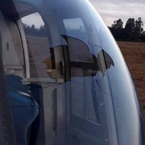 Drone penetrates helicopter windshield, injuring crew