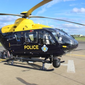 Man charged after UK police helicopter struck by laser